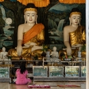 Many Buddha Statues And One Woman