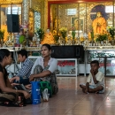 Local People Relaxing In Front Of Buddha Statues