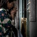 Woman Praying Seriously