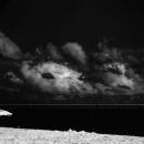 Dark Sky And A Derelict Beach Umbrella
