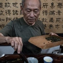 Man Setting Tea Leaves In Cup