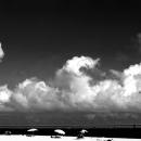 Beach Umbrellas, Clouds And Bridge