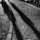 Long Shadows On The Stone-flagged Street