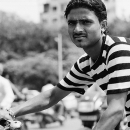 Man Wearing A Striped Shirt On The Bicycle @ India