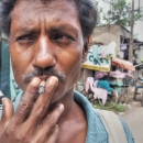 Man Smoking A Short Cigarette @ India