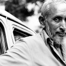 Taxi Driver With Gray Hair And White Beard