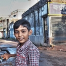 Boy Wearing A Checkered Shirt On The Bicycle @ India