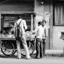 Tall Man At A Food Stall @ India