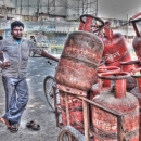 Man And Gas Cylinders @ India
