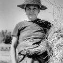 Farmer Carrying A Heap Of Straw Under Her Arm