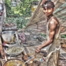 Young Man Working At A Fried Food Stall