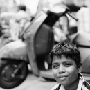 Boy Sitting In The Street @ India