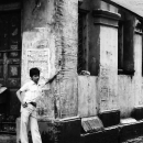 Young Man Standing At A Corner Of The Street