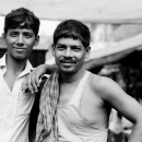 Two Men Working In The Fruit Market