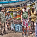 Men In Front Of A Fruit Store @ India
