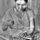 Woman Binding Books