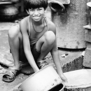 Boy Scrubbing Pans @ India