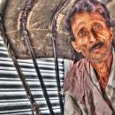 Rickshaw Wallah Sitting On The Seat @ India