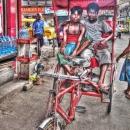 Two Men On A Red Rickshaw