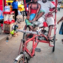 Two Men On A Red Rickshaw