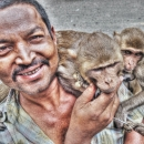 Man Putting Monkeys On His Shoulder