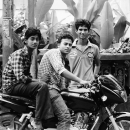 Three Men And A Motorbike