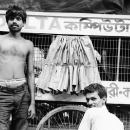 Two Men Beside A Wagon @ India