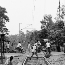 People On The Rail Crossing @ India