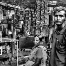 A Man And A Woman In Front Of A Shop @ India