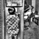 Boy In Front Of A Barber