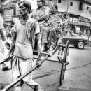 Rickshaw In The Traffic