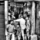 Men In Front Of A Shop