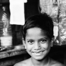 Boy Working At A Small Shop @ India