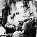 Man Sitting On A Cycle Rickshaw @ India