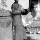 Monk Holding Cymbals