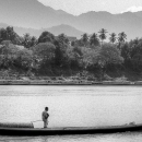 Man Standing On The Boat @ Laos