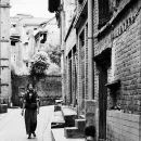 A Little Girl And A Woman In The Alley