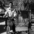 Man Getting On A Bike @ Laos