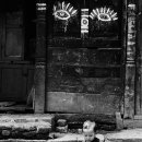 Boy In Front Of A Door With Eyes @ Nepal