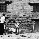 Boy And Man Beside An Old Building