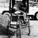 Sleeping On A Cycle Rickshaw