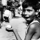 Boy Holding A Mango @ India