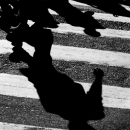 Shadows On The Pedestrian Crossing