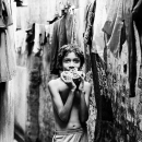 Boy And Laundries In The Lane @ India