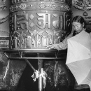 Umbrella, Big Prayer Wheel And Woman