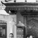 Prayer Wheel And A Buddhist Monk