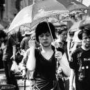 Woman Putting An Umbrella Up