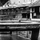 Figure With An Umbrella On The Bridge