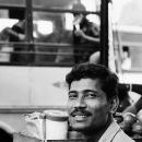 Faint Smile Of A Street Vendor