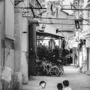 Three Boys Crouching In The Lane